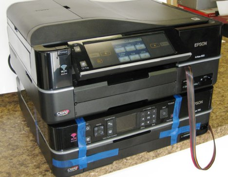 Epson Artisan 800 inkjet printer sitting on top of the Epson Refurbished Artisan 700 inkjet printer.