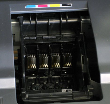 The Epson Stylus CX7400 inkjet printer with no cartridges installed.  This is what the print head looks like empty.