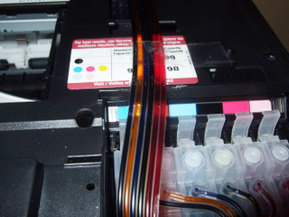 Epson Artisan 700 CIS tubing routing towards the back of the printer.  Comes out the back of the printer, tube lays flat.