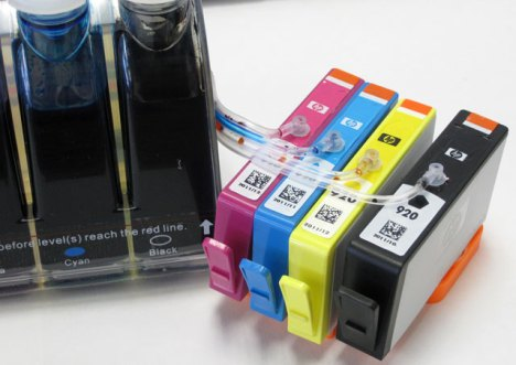 HP 920 Series Inkjet Printer Cartridges Next To A CIS SYSTEM