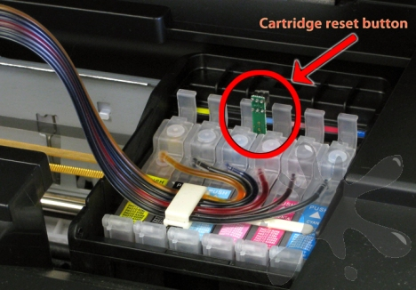 Epson Stylus Photo RX595 continuous inking system reset button on the outside of the cartridges.