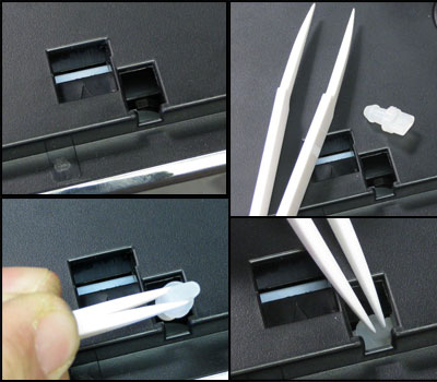 Use an included shipping plug to press down the lid closed latch on the printer.