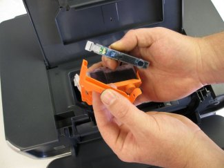 Removing the orange clips from the CLI-8, PGI-5 cartridge set for  install into the Canon Pixma iP4300. iP4200, iP4500