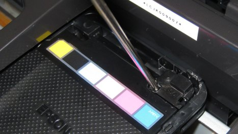 Where to pry the cover off an Epson Artisan 50 inkjet printer for use with a CI System, or CISS, CIS, Bulk Ink.