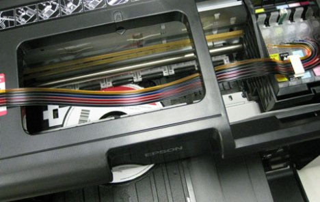 Epson Artisan 50 refurbished inkjet printer with CD-DVD tray inside printer during printing