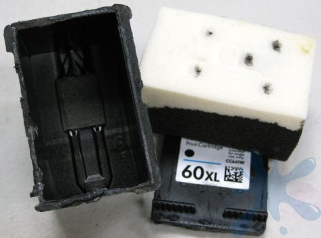 HP 60XL, 60 XL ink cartridge opened to expose the internal structure - removal of cartridge cap - remove top of ink cartridge.