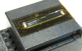 HP 901 black inkjet print cartridge empty and opened up to expose internal structure of ink cartridge