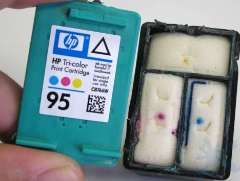 Hewlett Packard (HP) 95 color ink cartridge with cover removed to reveal the internal structure of the ink cartridge.