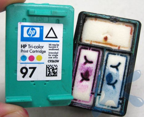 Hewlett Packard (HP) inkjet print cartridge HP 97 tri-color, color, opened up to expose internal structure