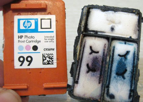 Removing the cartridge cover on the HP 99 photo color ink cartridge from Hewlett Packard - inkjet print cartridges.